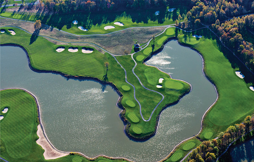 overhead shot of golf hole with large water hazard