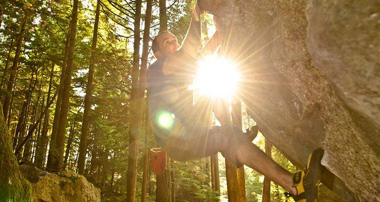 Man climbing boulders