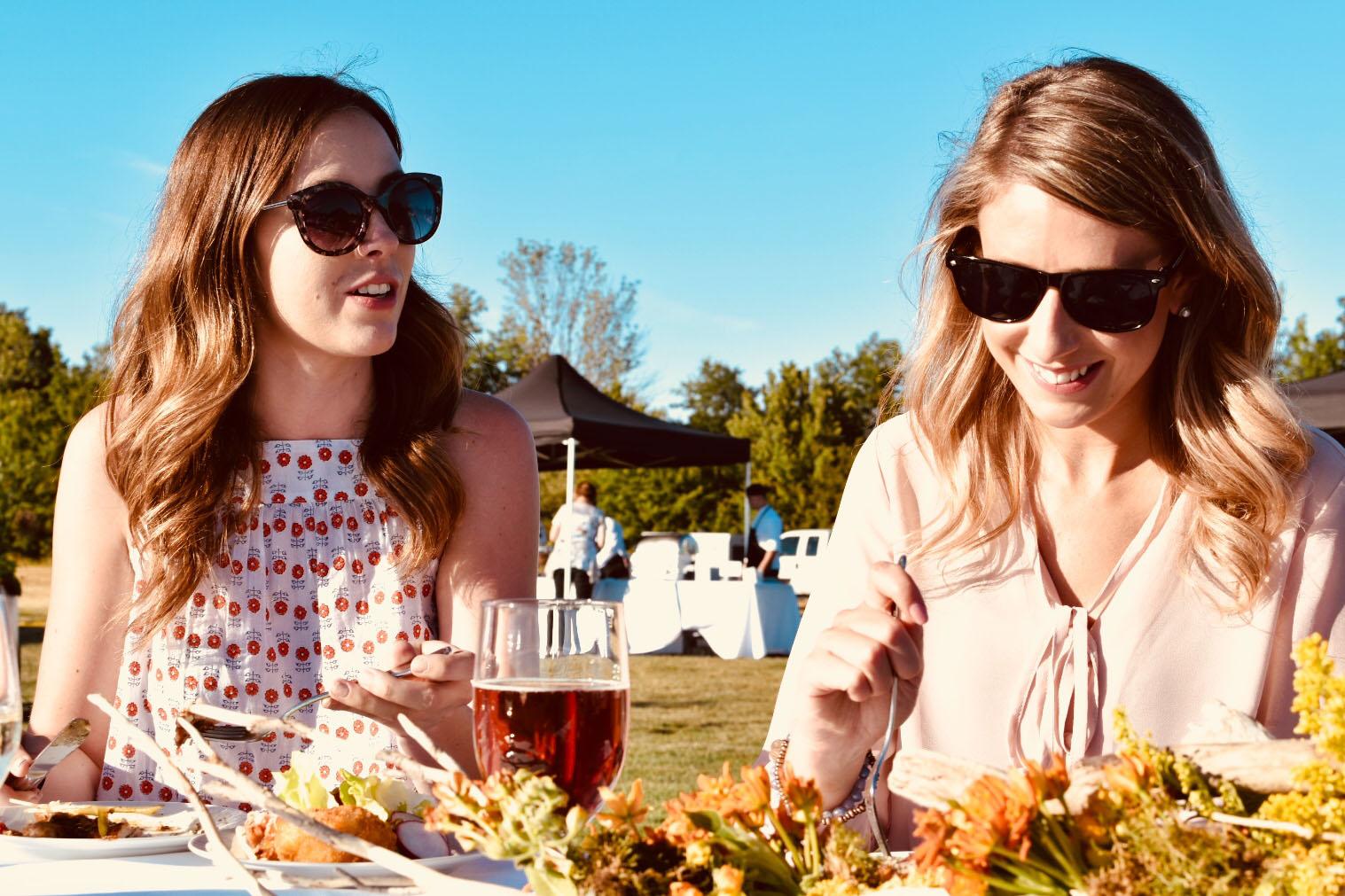 2 women eating dinner