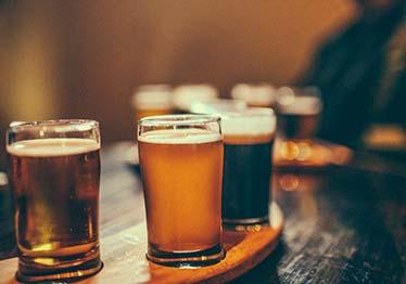 flight of beer full glasses