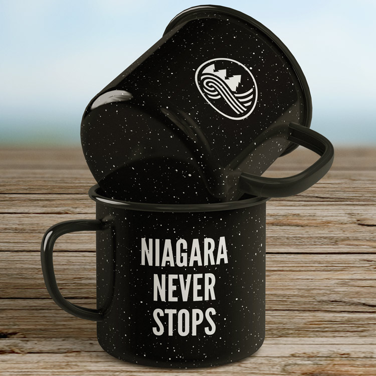 Mugs with Niagara Never Stops printed on front