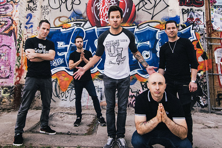 Band members of Simple Plan standing on a street
