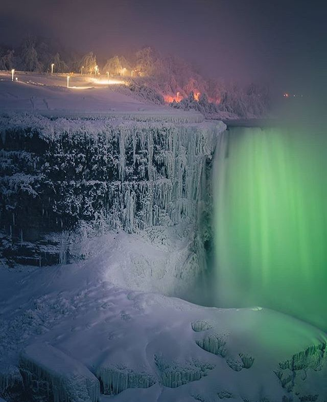 Glowing green on a winter night 🔦 Photo: @peter_in_to  #NiagaraParks