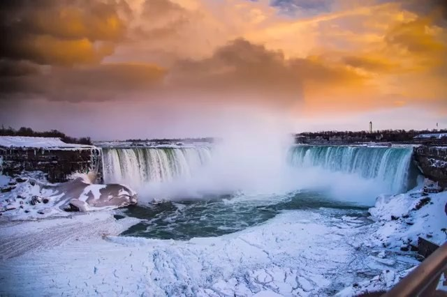Moody skies moving over an icy Horseshoe Falls during January's deep freeze in